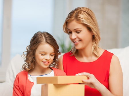 picture of mother and daughter with gift box photo
