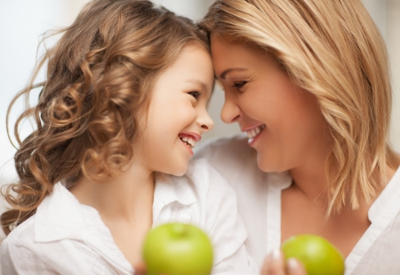 picture of mother and daughter with green apples photo
