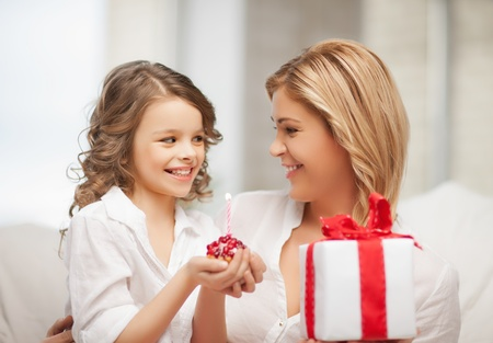 pre adult: picture of mother and daughter with cupcake Stock Photo