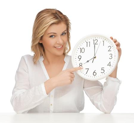 woman clock: imagen de la mujer en ropa casual con reloj