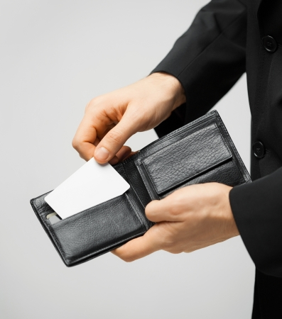 privilege: man in suit with wallet and credit card