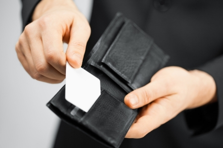 membership: man in suit with wallet and credit card