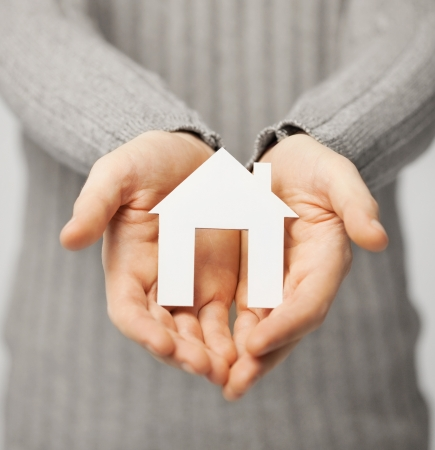 safe: bright picture of man holding paper house