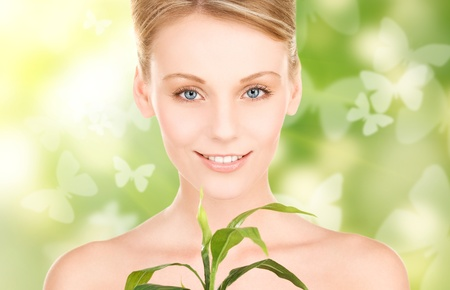 woman with sprout and butterflies over green background Stock Photo - 18258604