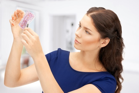 spurious: picture of lovely woman with euro cash money