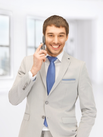 picture of handsome man with cell phone photo