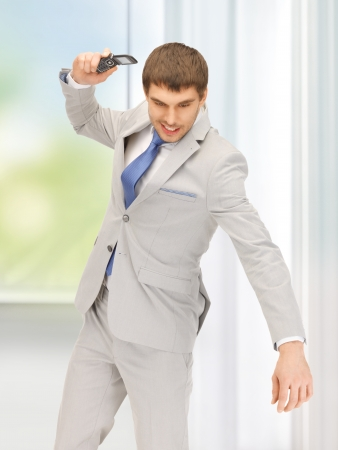 picture of angry man with cell phone Stock Photo - 18258901