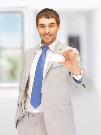 bright picture of confident businessman with business card