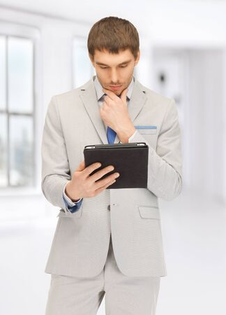 picture of calm man with tablet pc computer photo