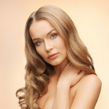 alluring: face and hands of beautiful woman with long hair Stock Photo