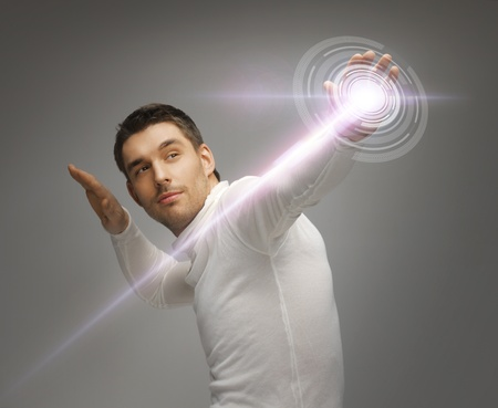 futuristic man: picture of futuristic man working with virtual screen