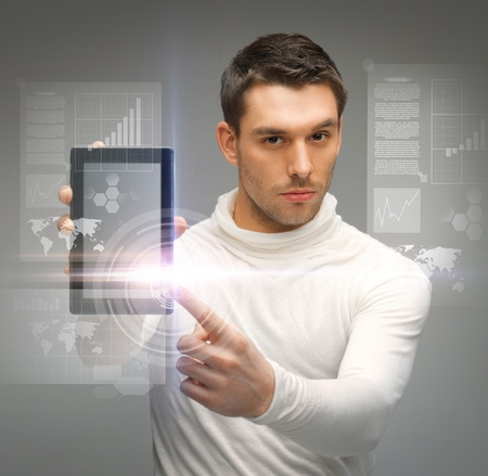 picture of man with tablet pc and virtual screens Stock Photo - 18299759