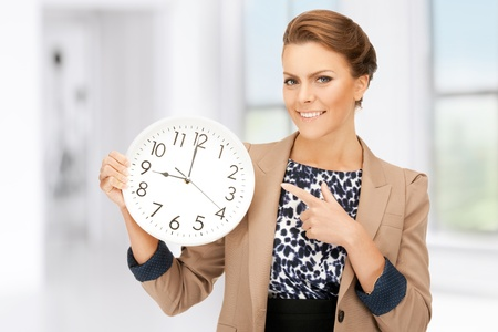 bright picture of woman holding big clock Stock Photo - 18299822