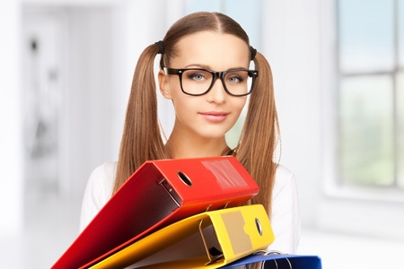 bright picture of beautiful woman with folders Stock Photo - 18299805