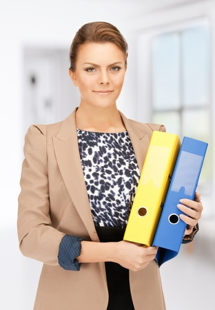 bright picture of beautiful woman with folders Stock Photo - 18299839