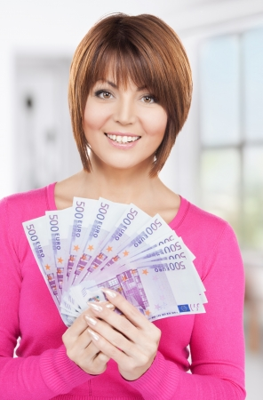 picture of lovely woman with euro cash money Stock Photo - 18299825