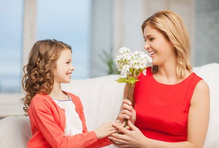 picture of mother and daughter with flowers Stock Photo - 18299821