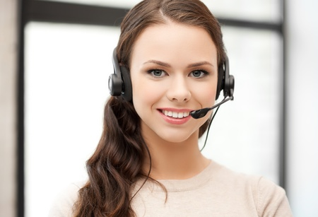 friendly female helpline operator with headphones Stock Photo - 18299774