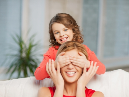mother and daughter making a joke or playing hide and seek Stock Photo - 18299826