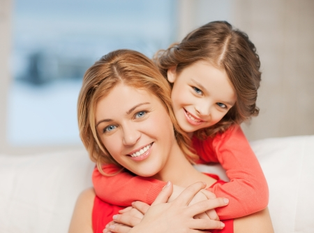 bright picture of hugging mother and daughter Stock Photo - 18299790