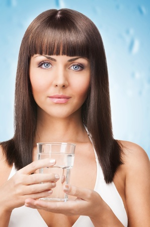 closeup picture of woman holding a glass of water Stock Photo - 18299800