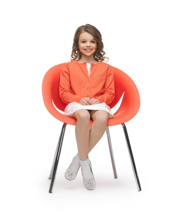 preteens: picture of beautiful liitle girl in casual clothes sitting on chair
