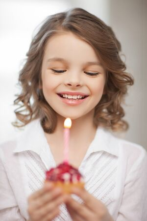 picture of beautiful pre-teen girl with cupcake Stock Photo - 18299795