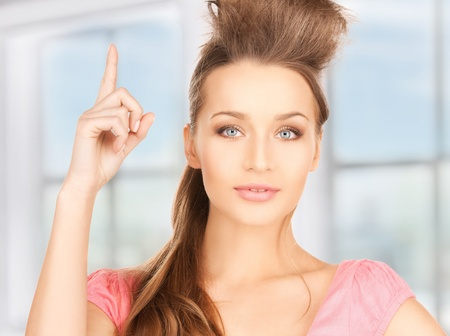 picture of attractive young woman with her finger up Stock Photo - 18299793