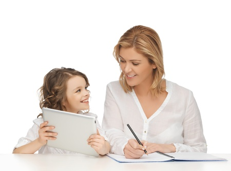 mother and daughter doing home work photo