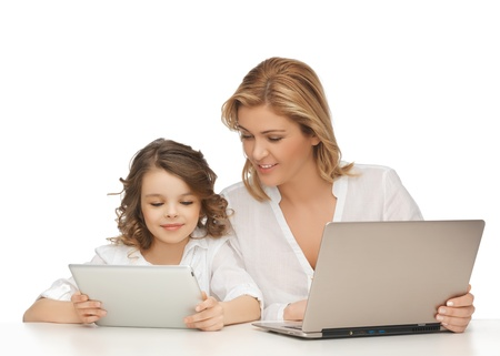 daughter: mother and daughter with laptop and tablet pc Stock Photo