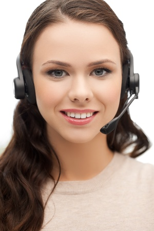 friendly female helpline operator with headphones Stock Photo - 18299802