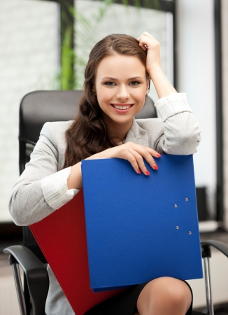 picture of beautiful smiling woman with folder Stock Photo - 18299833