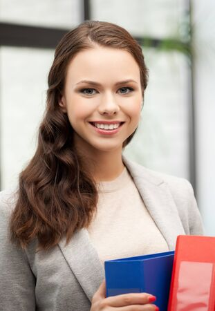 picture of beautiful smiling woman with folder Stock Photo - 18299829