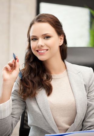 indoor picture of happy woman with documents writing something down Stock Photo - 18299806
