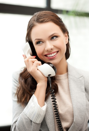 businesswoman with cell phone calling or talking Stock Photo - 18299812