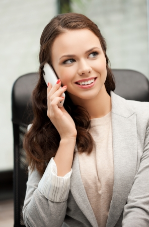 picture of businesswoman with cell phone calling or talking Stock Photo - 18299837