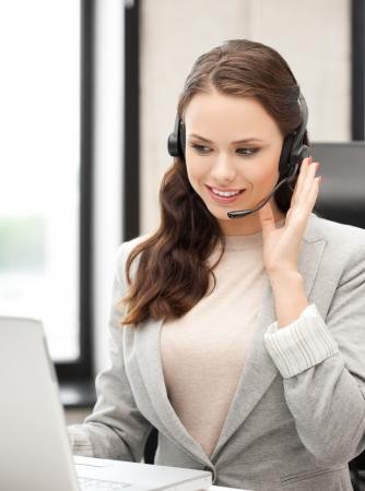 helpline: bright picture of smiling female helpline operator with headphones