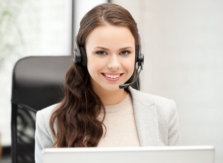 picture of smiling female helpline operator with headphones photo
