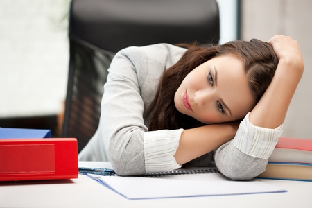 bored and tired woman behid the table Stock Photo - 18299798