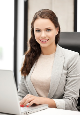 picture of smiling businesswoman using her laptop computer Stock Photo - 18299804