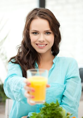 young woman holding glass of orange juice Stock Photo - 18299796