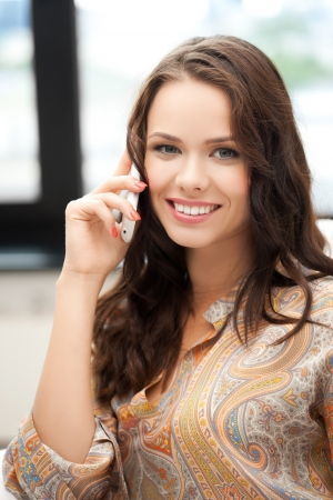 picture of young woman with mobile phone Stock Photo - 18299841