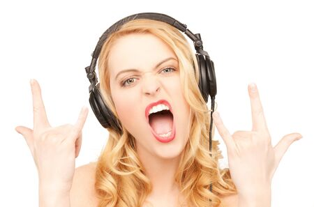 rock n: singing woman with headphones showing rock n roll sign