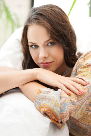 bright closeup picture of relaxed woman at home Stock Photo - 18299808