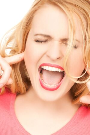 mad woman screaming holding her head with hands Stock Photo - 18299807
