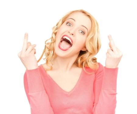 bright studio picture of excited young woman showing middle fingers Stock Photo