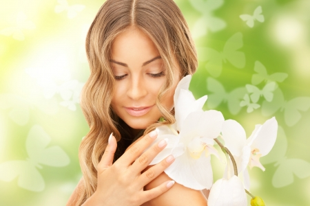 picture of beautiful woman with orchid flower and butterflies photo