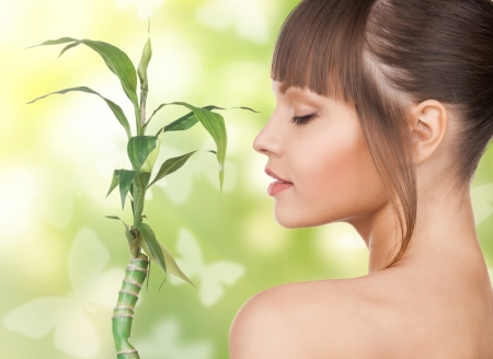 organic spa: woman with sprout and butterflies over green background