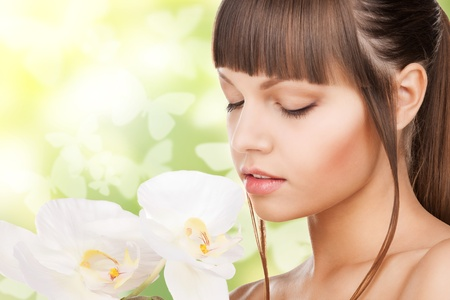picture of beautiful woman with orchid flower and butterflies Stock Photo - 18320848
