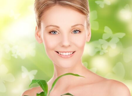 woman with sprout and butterflies over green background Stock Photo - 18388760